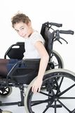 Disabled child girl in her wheelchair. A disabled child girl in her wheelchair royalty free stock photo