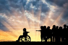 Disabled child in wheelchair crying and children chased him. Disabled child in a wheelchair crying and children chased him sunset. Concept disabled child Stock Photos