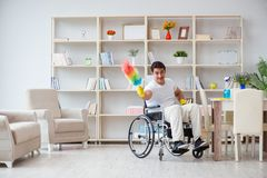 The disabled cleaner doing chores at home Stock Photography