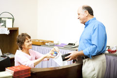 Free Disabled Clerk Serves Customer Stock Photo - 15659390