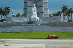 Disabled cuban car. A car is disabled in front of the monument to the revolution in Havana royalty free stock image