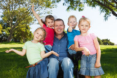 Disabled dad play with children Stock Photo