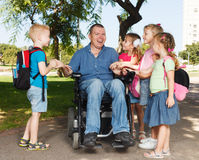 Disabled dad play with children Stock Photos
