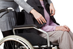 Disabled with daughter. Disabled woman is cared by her daughter Royalty Free Stock Images