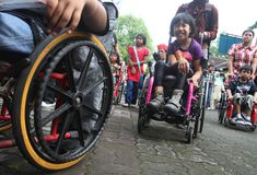 Disabled day. Number of student with disability doing parade across town in order to commemorating disabled day in solo, central java, indonesia Royalty Free Stock Image