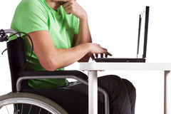 Disabled by desk Royalty Free Stock Photo