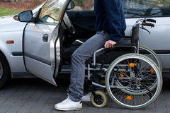 Disabled driver getting into a car Royalty Free Stock Photos