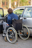Disabled driver next his car Stock Photos