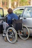 Disabled driver next his car Stock Photos