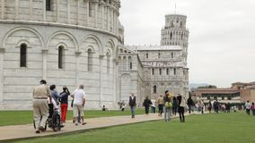 Disabled/elderly tourists in Piazza dei Miracoli, Pisa, Italy. Royalty Free Stock Images