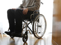 Disabled elderly in a wheelchair in the room Royalty Free Stock Photos