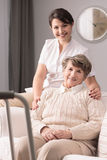 Disabled elderly woman and caregiver. Picture of disabled elderly women and happy caregiver Royalty Free Stock Photos