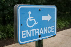 Disabled entrance sign. A blue disabled entrance sign Stock Images