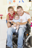 Disabled father with his children Royalty Free Stock Photo