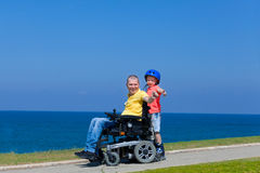 Disabled Father play with his son Stock Images