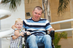 Disabled father play with little son royalty free stock photo