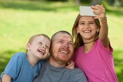 Disabled father playing with children. stock photo