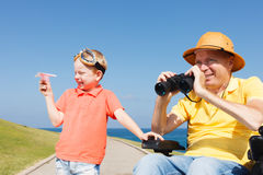 Disabled father and son play with Binocular Royalty Free Stock Photography