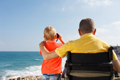 Disabled father and son play with binocular Stock Photos
