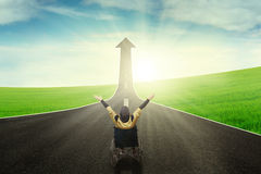 Disabled female with upward arrow on road Stock Image