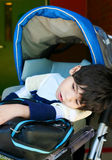 Disabled five year old boy in wheelchair Royalty Free Stock Photos