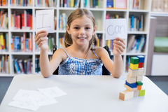 Disabled girl holding placard that reads I Can in library Royalty Free Stock Photos