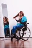 Disabled girl looking at mirror. Stock Photos