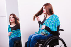 Disabled girl looking at mirror. Stock Image