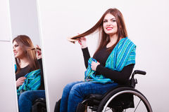 Disabled girl looking at mirror. Royalty Free Stock Photo