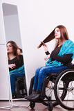 Disabled girl looking at mirror. Royalty Free Stock Images