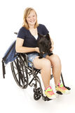 Disabled Girl with Scotty Dog. Disabed teen girl with her backpack and her Scotty dog.  Full body isolated on white Royalty Free Stock Photo