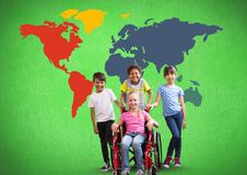 Disabled girl in wheelchair with friends in front of colorful world map Royalty Free Stock Photos