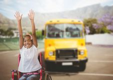 Disabled girl in wheelchair in front of school bus royalty free stock images