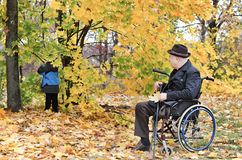Disabled grandfather and grandchild outdoors Royalty Free Stock Images