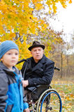 Disabled grandfather and grandchild Royalty Free Stock Photo