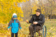 Disabled grandfather playing with his grandson Royalty Free Stock Photography