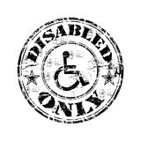 Disabled grunge rubber stamp. Black grunge rubber stamp with the disabled symbol and the text disabled only written inside the stamp Royalty Free Stock Photography