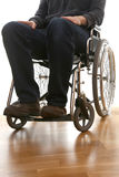 Disabled guy in a wheelchair. Young disabled man in a wheelchair in his bedroom Royalty Free Stock Images