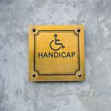 Disabled Handicap Icon and wording Handicap Sign made from gold stock image