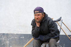 Sad disabled homeless man royalty free stock photography