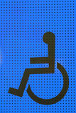 Disabled icon on blue grating metal Royalty Free Stock Images