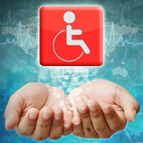 Disabled icon on hand Stock Photo