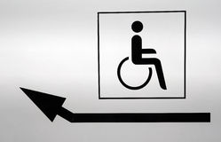 Disabled icon with a pointing arrow Royalty Free Stock Photography