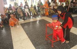 Disabled kids doing fashion show. In solo, central java, Indonesia Stock Photo