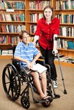 Disabled Kids at School. Disabled girl and boy in the school library Stock Image