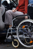 Disabled lady ready to drive Stock Photography