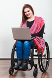 Disabled lady surfing on web. Stock Photos