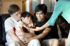 Disabled little boy blowing  candles Royalty Free Stock Photography