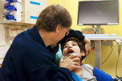 Disabled little boy in doctor`s office getting check up Royalty Free Stock Photo