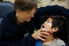 Disabled little boy in doctor`s office getting check up Stock Photography